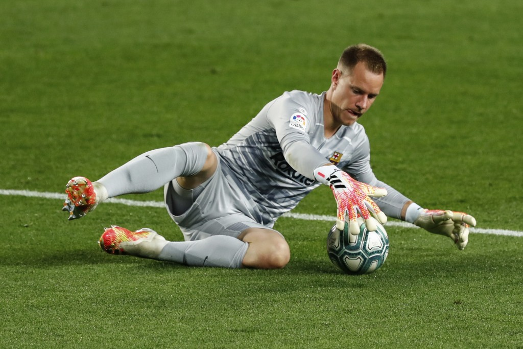 Barcelona's goalkeeper Marc-Andre ter Stegen stops the ball during the Spanish La Liga soccer match between FC Barcelona and Atletico Madrid at the Ca...