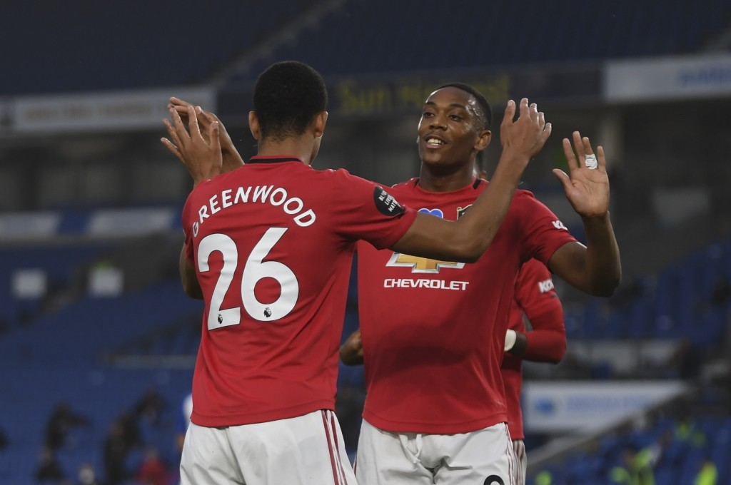 Manchester United players celebrate the opening goal of their team during the English Premier League soccer match between Brighton & Hove Albion and M...