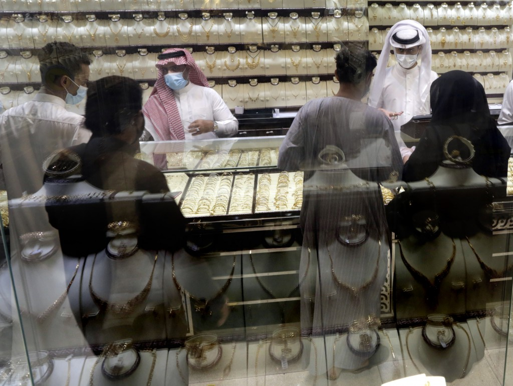 Saudis buy jewels at the gold market a day before the expected increase of VAT from 5% to 15%, in Jiddah, Saudi Arabia, Tuesday, June 30, 2020. (AP Ph...