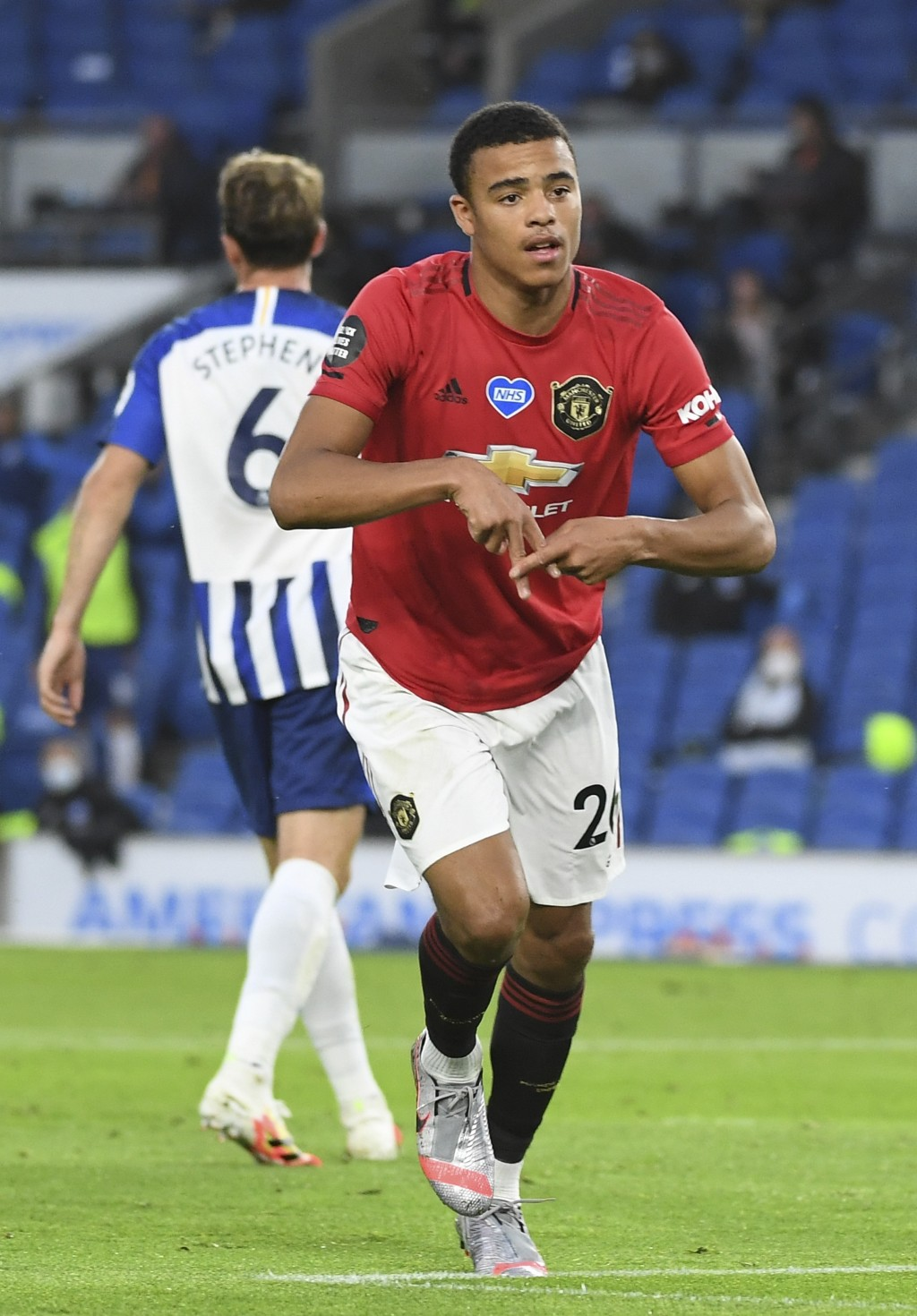 Manchester United's Mason Greenwood celebrates after scoring the opening goal of his team during the English Premier League soccer match between Brigh...