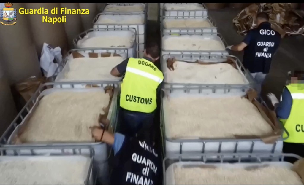 This image taken from a video shows customs police officers inspecting boxes full of amphetamines pills that were seized at the Salerno harbor, southe...
