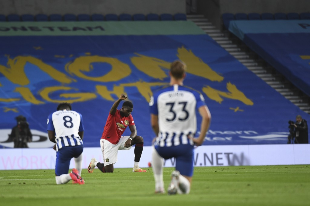 Manchester United's Paul Pogba kneels before the English Premier League soccer match between Brighton & Hove Albion and Manchester United at the AMEX ...