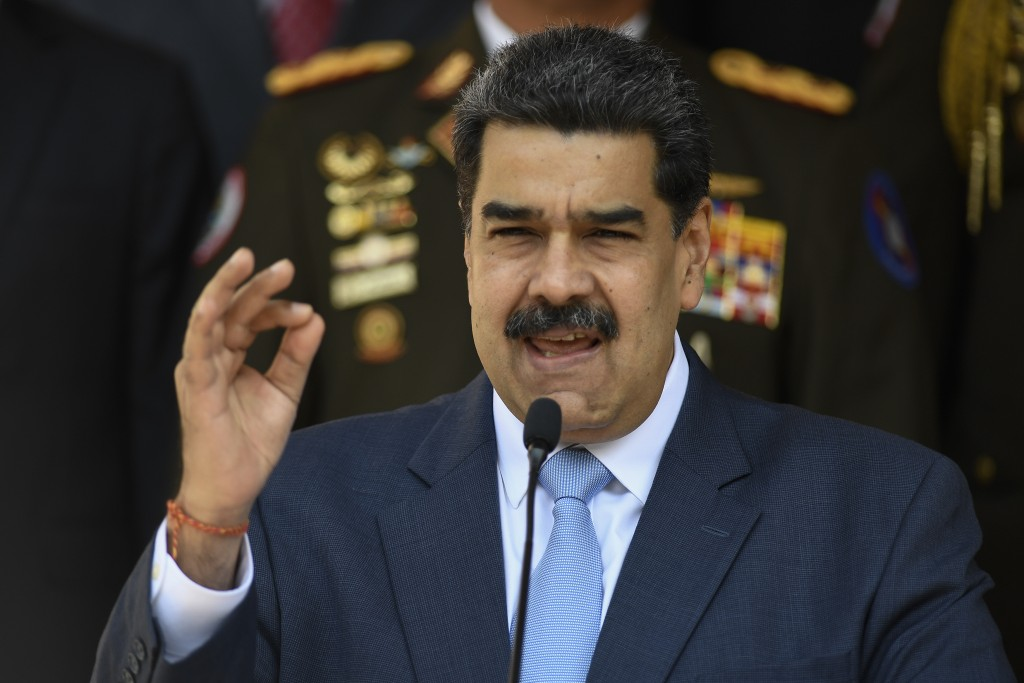 FILE - In this March 12, 2020 file photo, Venezuelan President Nicolas Maduro speaks during a press conference at the Miraflores Presidential Palace i...
