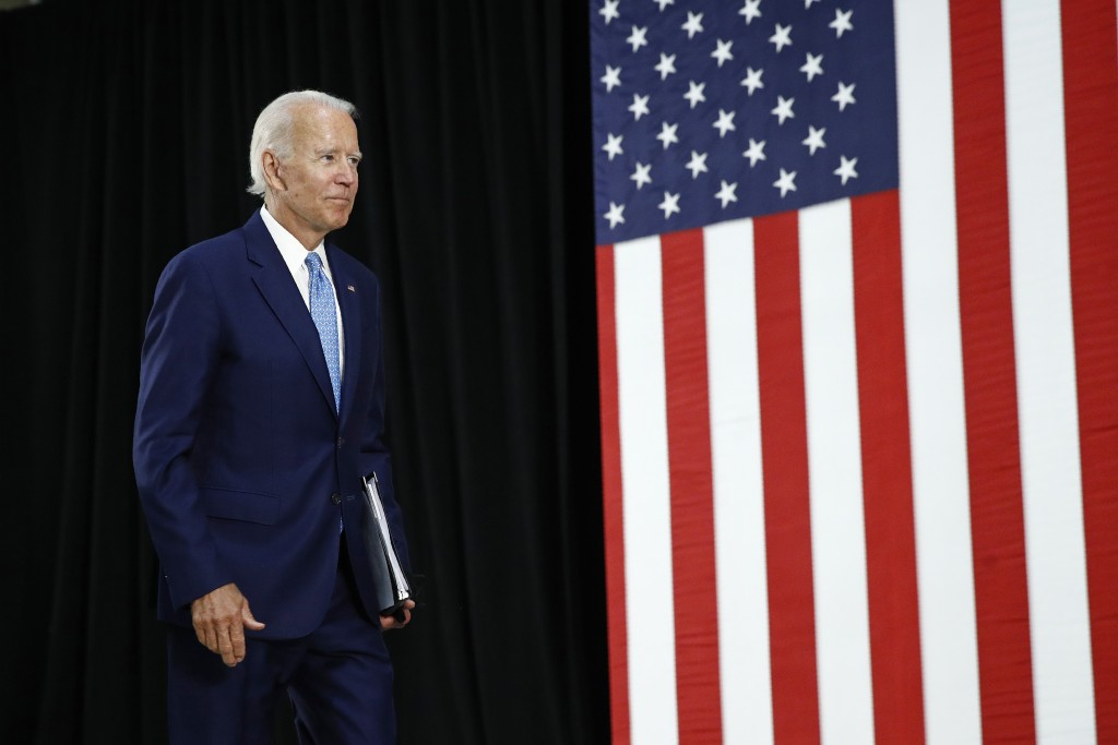 Democratic presidential candidate, former Vice President Joe Biden departs after speaking at Alexis Dupont High School in Wilmington, Del., Tuesday, J...