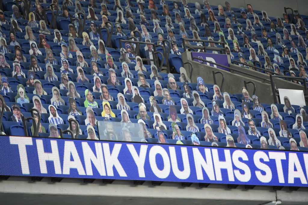 Photographs of fans are placed on the seats ahead of the English Premier League soccer match between Brighton & Hove Albion and Manchester United at t...