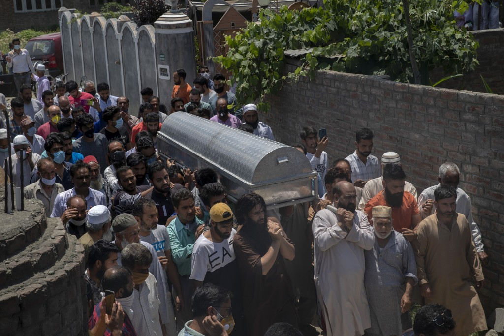 Relatives and neighbors carry the coffin of civilian Bashir Ahmed Khan during his funeral on the outskirts of Srinagar, Indian controlled Kashmir, Wed...
