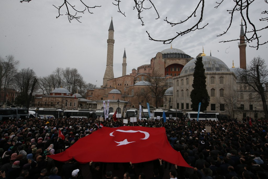 FILE - In this Saturday, March 16, 2019 file photo, backdropped by Hagia Sophia, the Byzantine-era cathedral that was turned into a mosque and now ser...