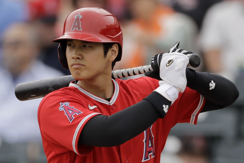 FILE - In this  Friday, Feb. 28, 2020 file photo, Los Angeles Angels' Shohei Ohtani bats during the first inning of a spring training baseball game ag...