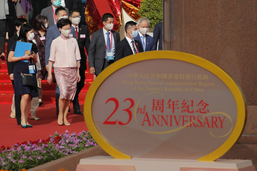 Hong Kong Chief Executive Carrie Lam, second from left, and her husband Lam Siu-por, far right, arrive to attend a flag raising ceremony at the Golden...