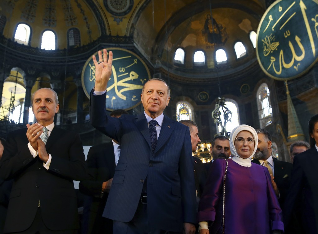 FILE - In this Saturday, March 31, 2018 file photo, Turkey's President Recep Tayyip Erdogan, centre, accompanied by his wife Emine, right, waves to su...