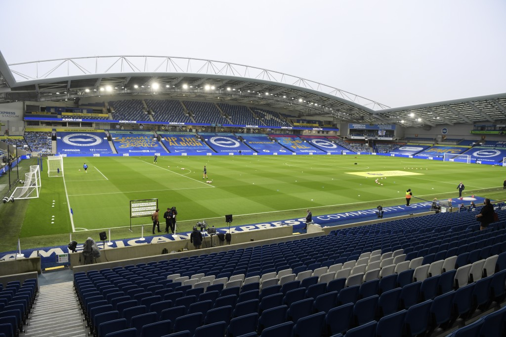 Players warm-up ahead of the English Premier League soccer match between Brighton & Hove Albion and Manchester United at the AMEX Stadium in Brighton,...