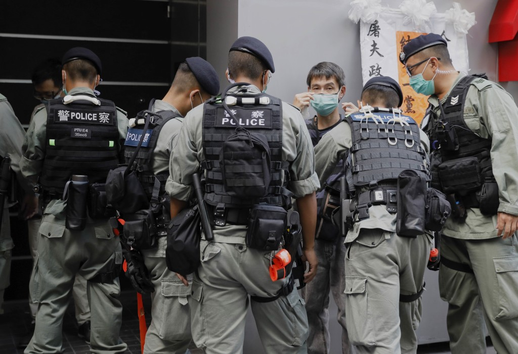 Police prepare for pro-democracy protesters' rally against the security law for Hong Kong, Wednesday, July 1, 2020. Hong Kong marked the 23rd annivers...