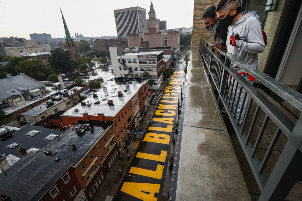 """FILE - In this June 27, 2020, file photo, a mural that reads """"ALL BLACK LIVES MATTER"""" is painted on Halsey Street in Newark, N.J. Thousands of Black a..."""