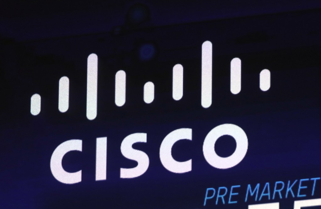 FILE - In this Oct. 3, 2018, file photo, the Cisco logo appears on a screen at the Nasdaq MarketSite in New York's Times Square. California regulators...