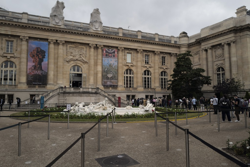 Visitors wait to enter at the Pompei exhibition in the Grand Palais Museum, in Paris, Wednesday, July 1, 2020. The Grand Palais re-opens after the lon...