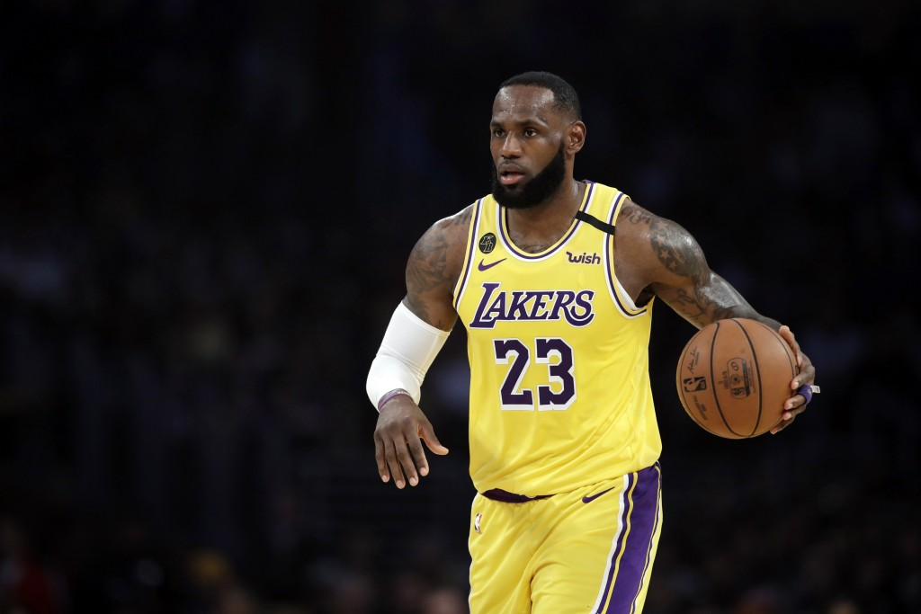 FILE - In this March 10, 2020, file photo, Los Angeles Lakers' LeBron James (23) dribbles during the first half of an NBA basketball game against the ...