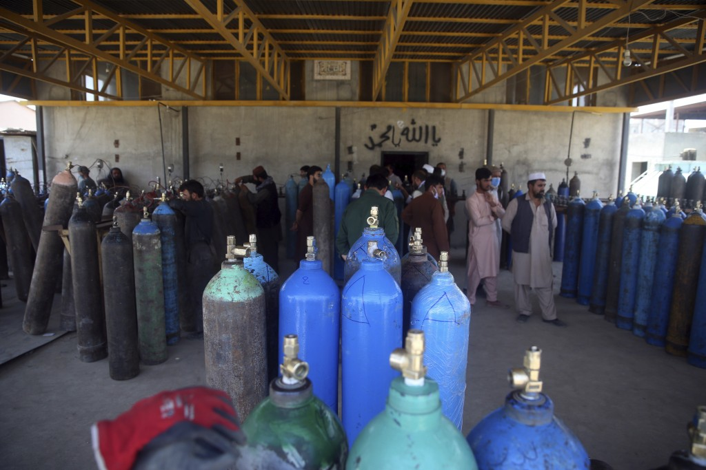 People line up for free oxygen at a privately owned oxygen factory, in Kabul, Afghanistan, Thursday June 18, 2020. For seven years, Najibullah Seddiqi...