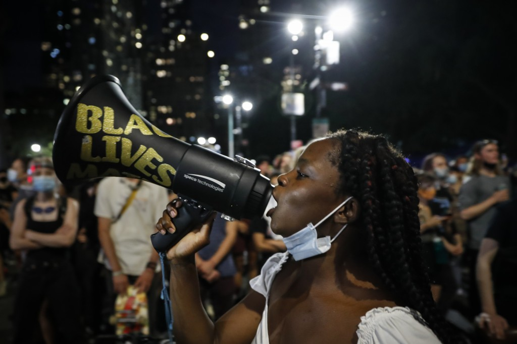 FILE - In this  June 30, 2020, file photo, protesters gather at an encampment outside City Hall in New York. Thousands of Black activists from across ...