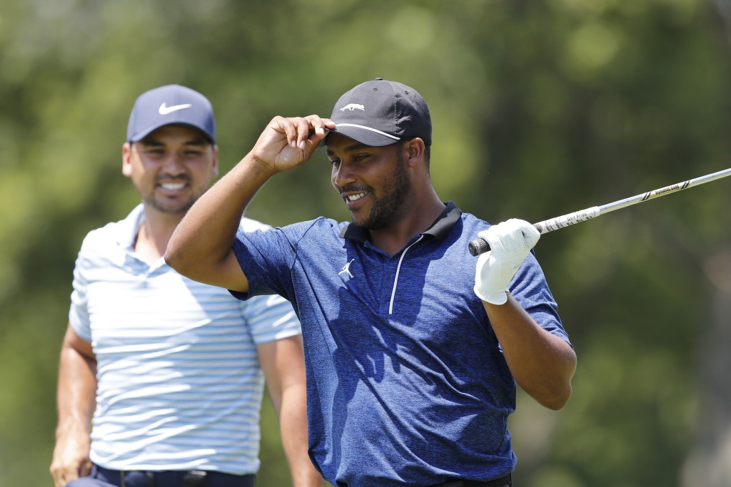 Harold Varner III prepares to hit his tee shot on the 15th hole during a nine-hole exhibition ahead of the Rocket Mortgage Classic golf tournament, We...