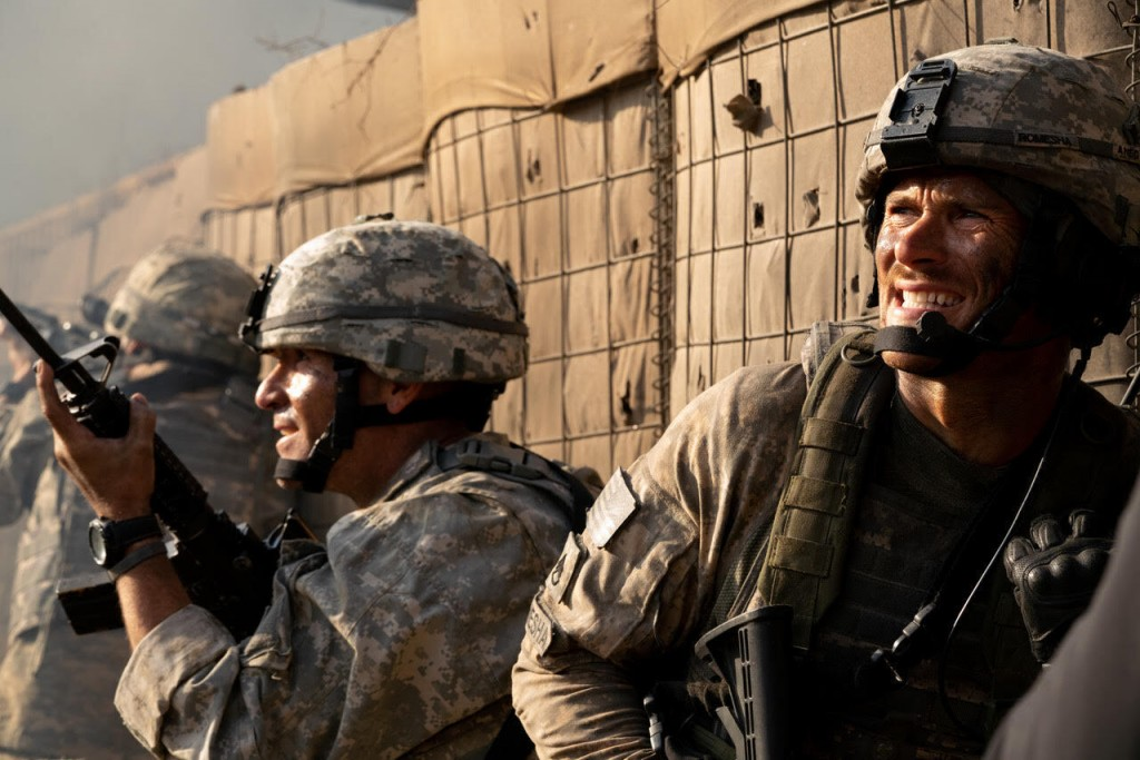 "This image released by Screen Media shows Scott Eastwood, right, in a scene from ""The Outpost."" The film tells the story of the heroic Battle of Kamde..."