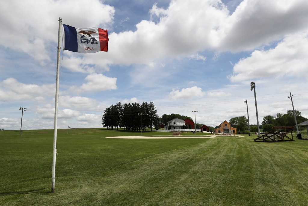 FILE - In this June 5, 2020, file photo, an Iowa flag waves in the wind over the field at the Field of Dreams movie site in Dyersville, Iowa. The St. ...