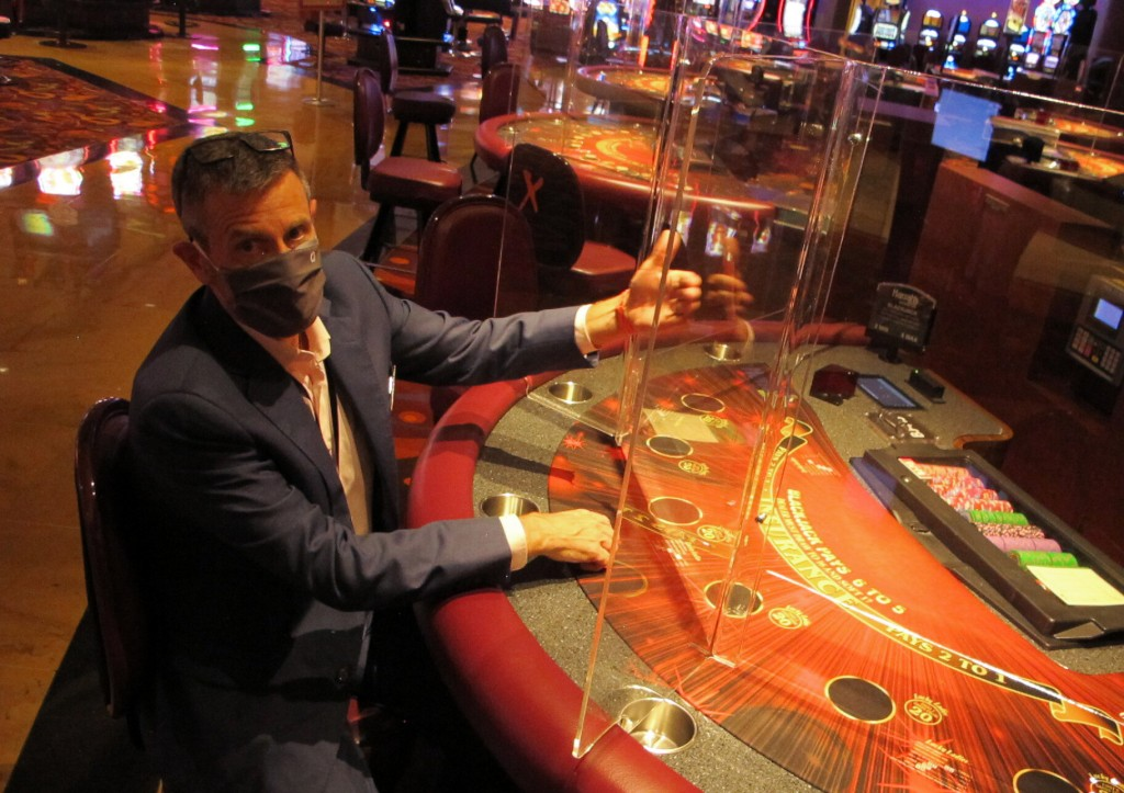 Ron Baumann, a regional president with Caesars Entertainment, sits Wednesday, July 1, 2020, at a card table at Harrah's casino in Atlantic City, N.J.,...