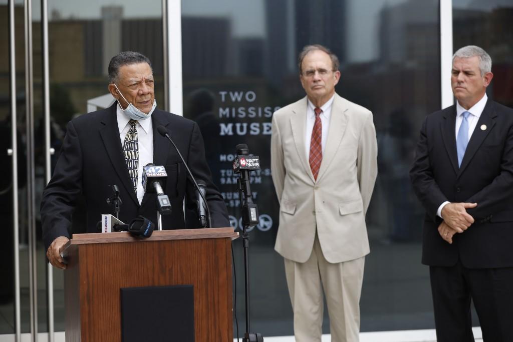 Mississippi Lt. Gov. Delbert Hosemann, center, and House Speaker Philip Gunn, R-Clinton, listen as Reuben Anderson, chairman of the board of the Missi...