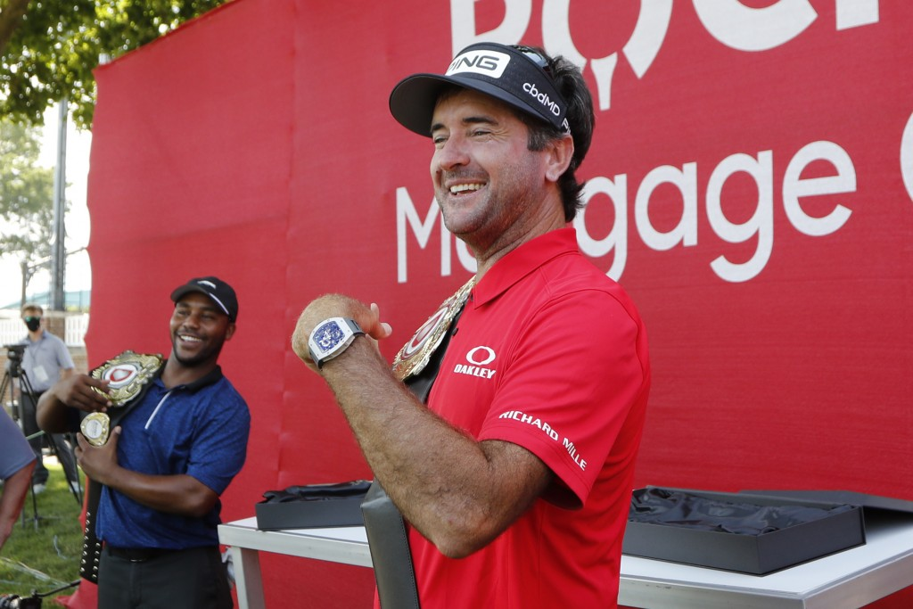 Bubba Watson and Harold Varner III, left, show off the winner's belts after their win in a nine-hole exhibition against Jason Day and Wesley Bryan ahe...