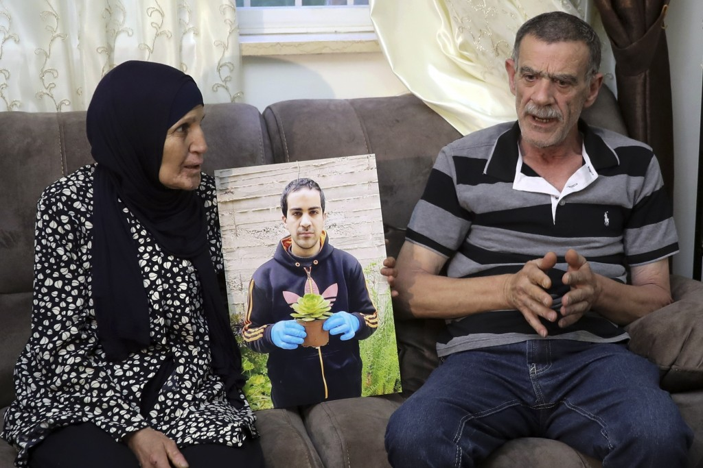 Parents of Eyah Hallaq, an autistic Palestinian man who was fatally shot by Israeli police, Khiri and mother Rana, talk during an interview In Jerusal...