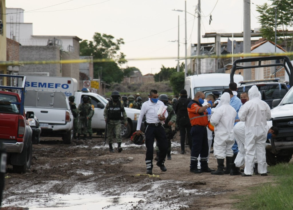 Forensic service personnel prepare to enter an unregistered drug rehabilitation center in Irapuato, Mexico, Wednesday, July 1, 2020. Gunmen burst into...
