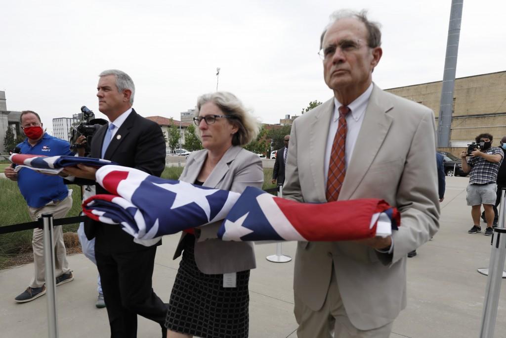 Speaker Philip Gunn, R-Clinton, left, Lt. Gov. Delbert Hosemann, right, and Mississippi Department of Archives and History Director Katherine Blount, ...