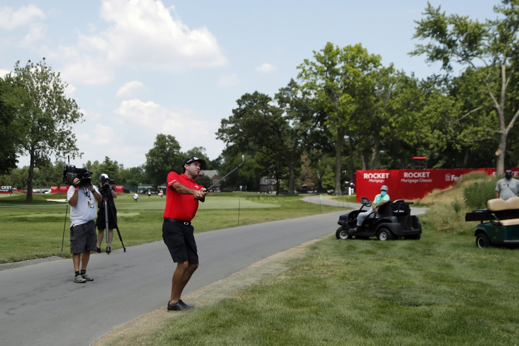 Bubba Watson hits onto the 17th green drives during a nine-hole exhibition ahead of the Rocket Mortgage Classic golf tournament, Wednesday, July 1, 20...