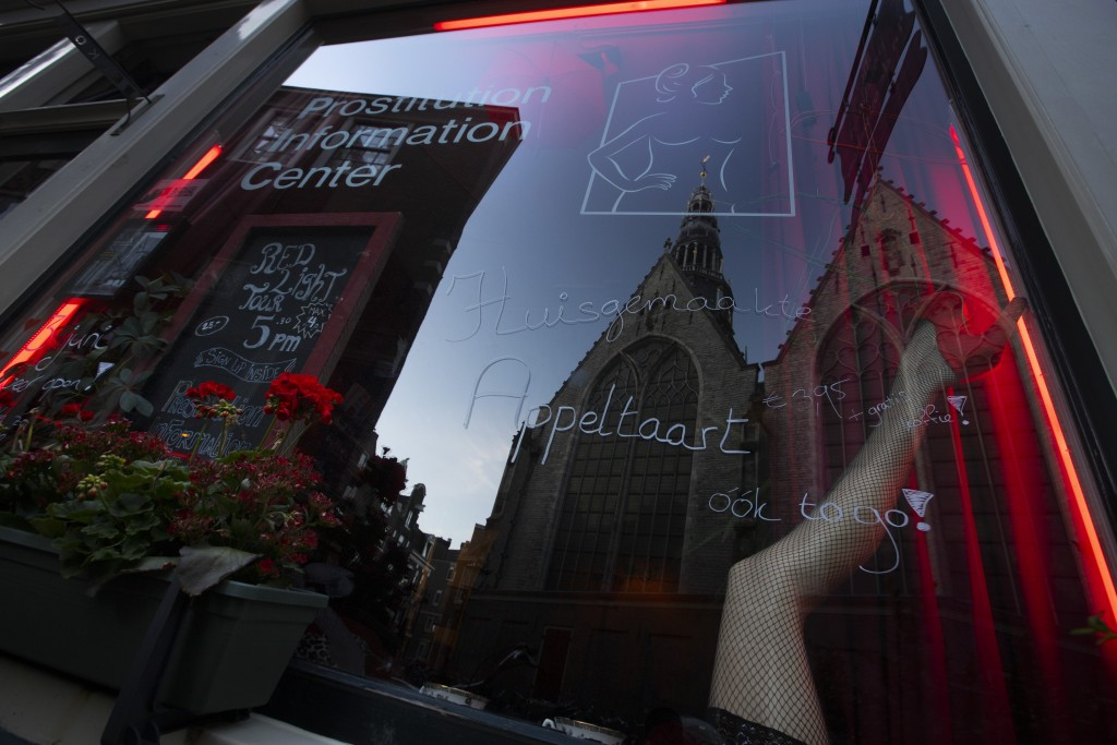 Oude Kerk, or Old Church, is reflected in the window of the PIC, Prostitution Information Center, as sex workers welcomed clients again in the Red Lig...