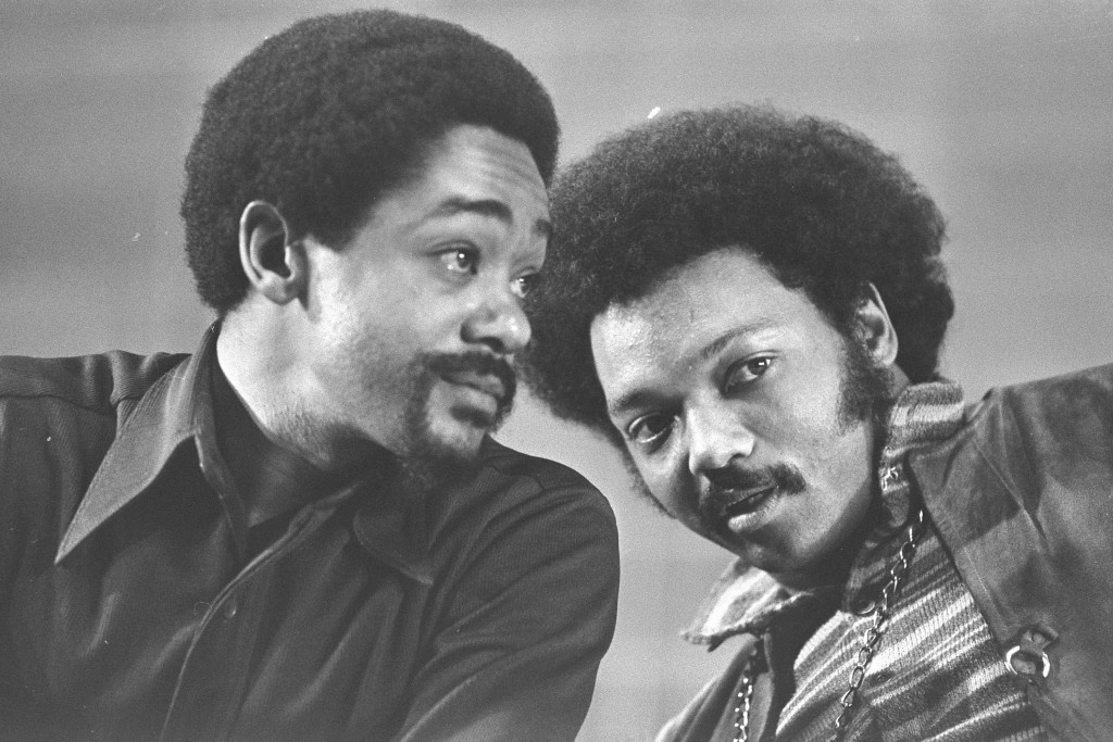 FILE - In this March 12, 1972, file photo, Bobby Seale, left, and the Rev. Jesse Jackson talk at the National Black Political Convention in Gary, Ind....