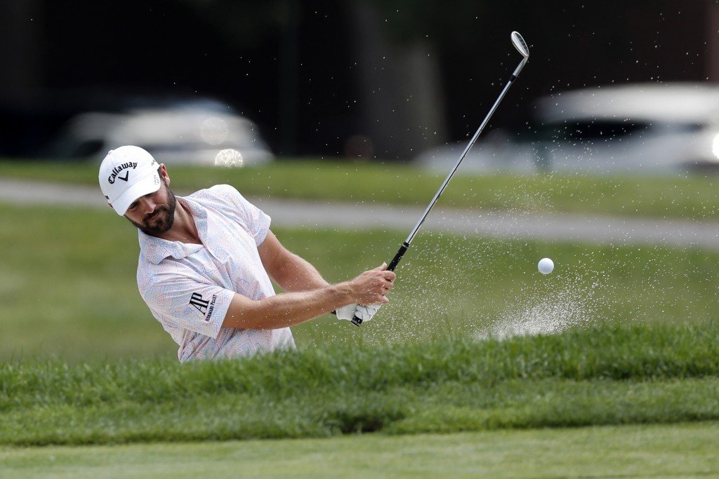 Wesley Bryan hits onto the 17th green drives during a nine-hole exhibition ahead of the Rocket Mortgage Classic golf tournament, Wednesday, July 1, 20...