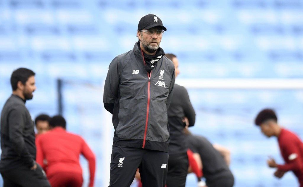 Liverpool's manager Jurgen Klopp watches as his players warm up ahead of the English Premier League soccer match between Manchester City and Liverpool...