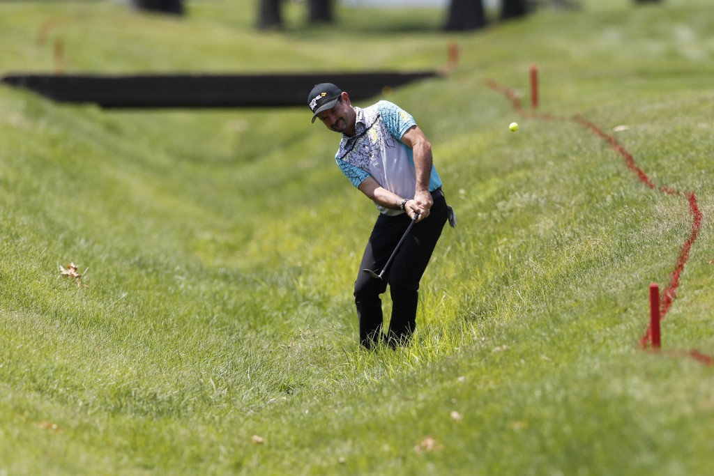 Rory Sabbatini hits from a hazard on the 18th hole during the first round of the Rocket Mortgage Classic golf tournament, Thursday, July 2, 2020, at t...