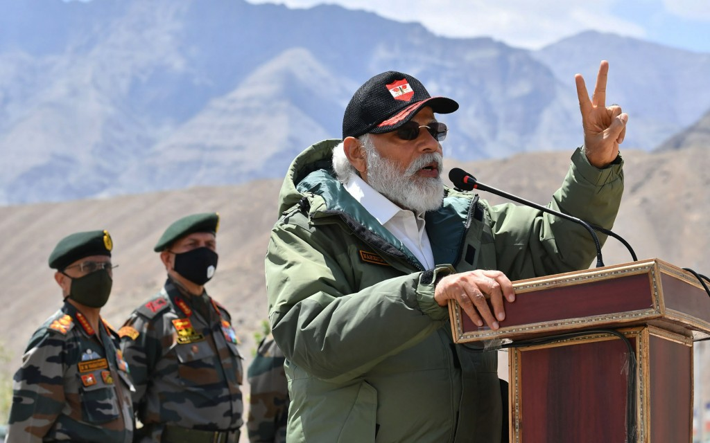In this handout photo provided by the Press Information Bureau, Indian Prime Minister Narendra Modi adresses soldiers during a visit to Nimu, Ladakh a...