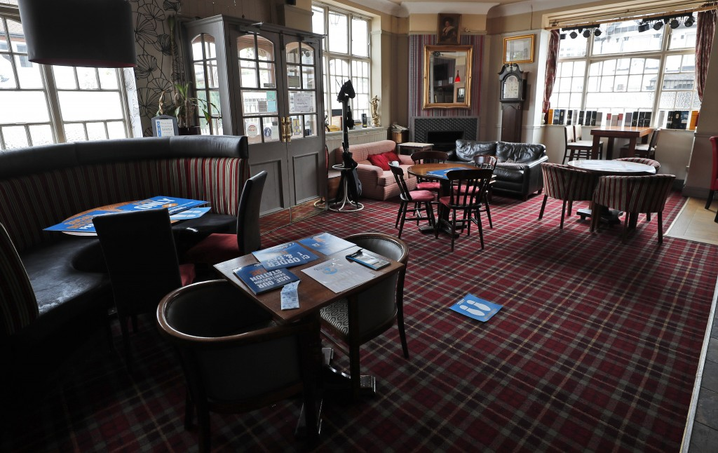 Tables are arranged for social distancing at the Chandos Arms pub in London, Wednesday, July 1, 2020. Asking people in English pubs to keep their dist...