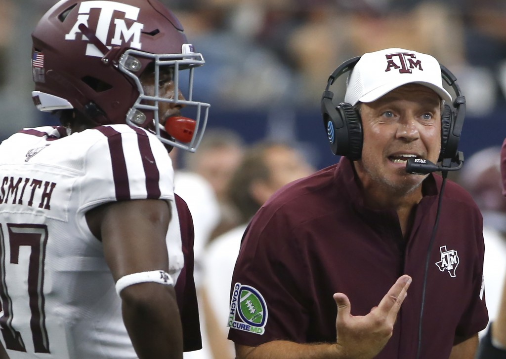 FILE - In this Sept. 28, 2019, file photo, Texas A&M head coach Jimbo Fisher talks with his team as wide receiver Ainias Smith (17) looks on as they p...