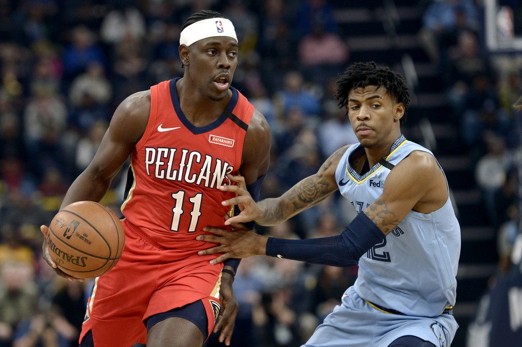 FILE - In this Monday, Jan. 20, 2020 file photo, New Orleans Pelicans guard Jrue Holiday (11) handles the ball against Memphis Grizzlies guard Ja Mora...