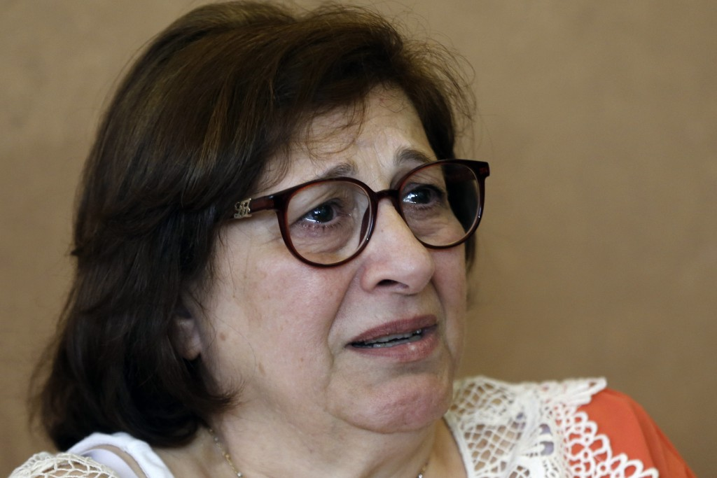 Laure Ghosn, whose husband Charbel Zogheib has been missing for the past 37 years, cries as she speaks during an interview at her home in Sarba, north...