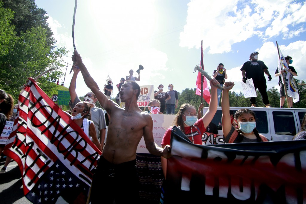 Native American protesters form a roadblock on the road leading to Mount Rushmore ahead of President Donald Trump's visit to the memorial on Friday, J...