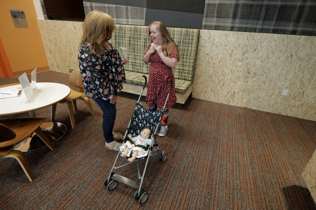 Connie Wade, left, talks with her daughter Emilyanne, 12, Wednesday, June 17, 2020, in the lobby area of Mary's Place, a family homeless shelter locat...
