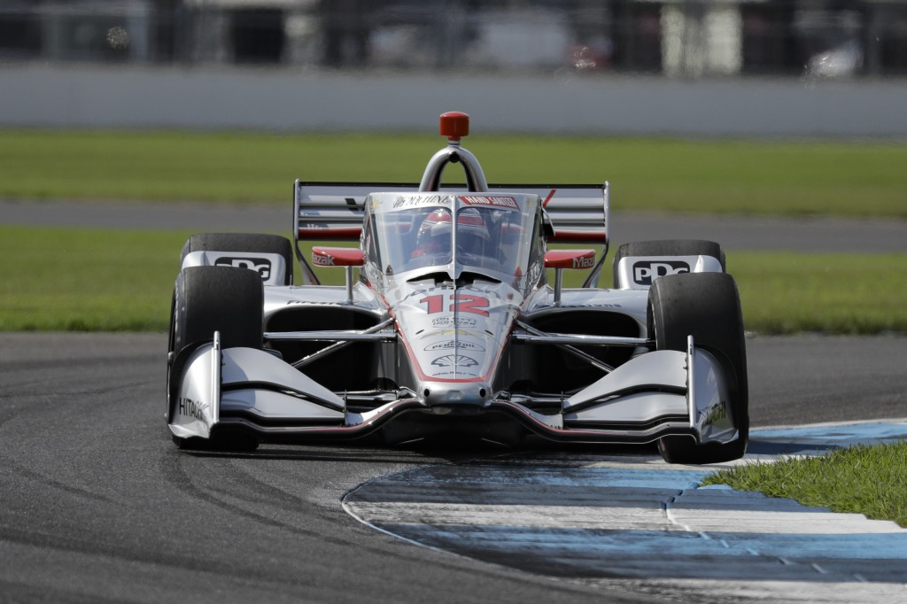 Race driver Will Power, of Australia, drives through a turn during qualifying for the IndyCar auto race at Indianapolis Motor Speedway in Indianapolis...