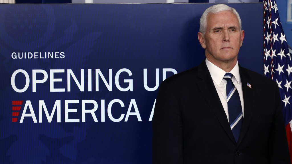 FILE - In this April 16, 2020, file photo, Vice President Mike Pence listens as President Donald Trump speaks about the coronavirus in the James Brady...