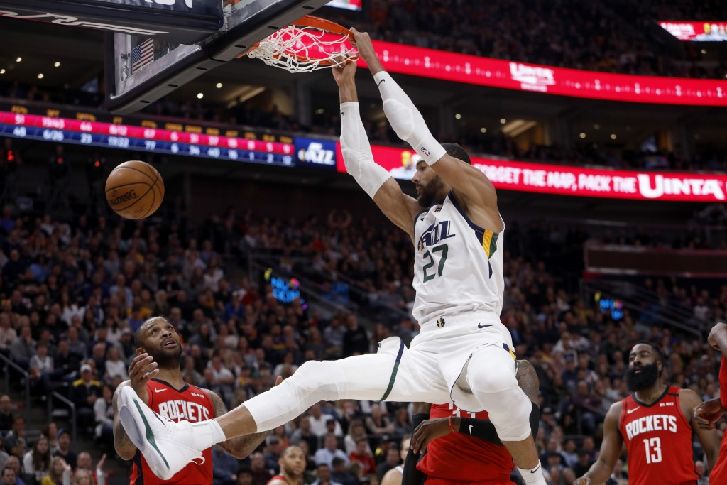 FILE - In this Feb. 22, 2020, file photo, Utah Jazz's Rudy Gobert (27) dunks during the second half of an NBA basketball game against the Houston Rock...