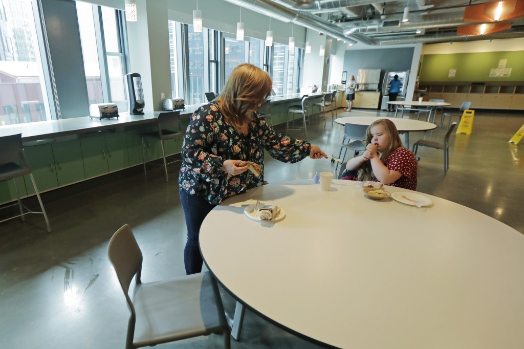 Connie Wade, left, prepares to eat lunch with her daughter Emilyanne, 12, Wednesday, June 17, 2020, at Mary's Place, a family homeless shelter located...