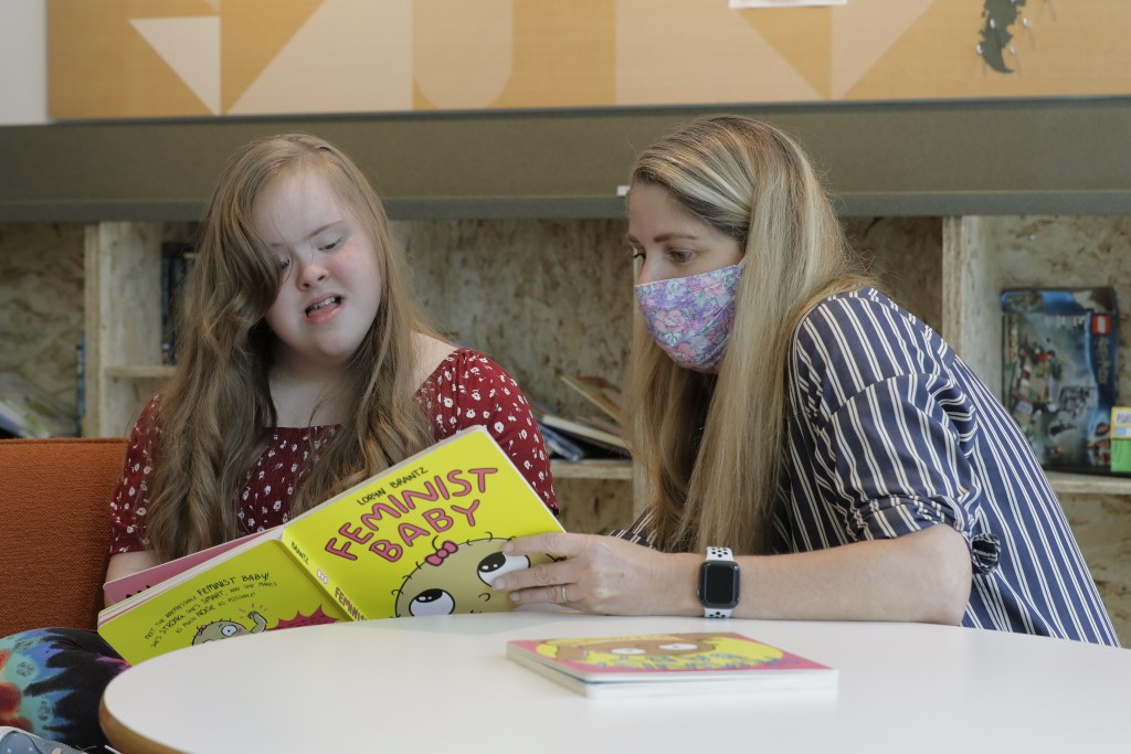Tricia Nora, right, a pediatric nurse practitioner who works at Mary's Place, a family homeless shelter located inside an Amazon corporate building, r...