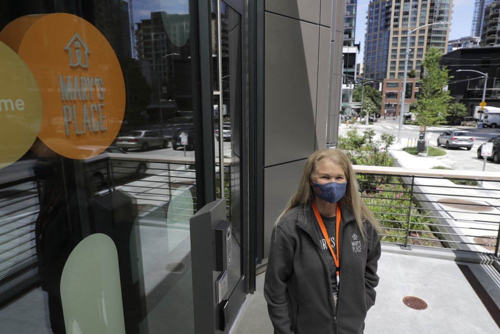 Marty Hartman, executive director of Mary's Place, a family homeless shelter located inside an Amazon corporate building, poses for a photo, Wednesday...